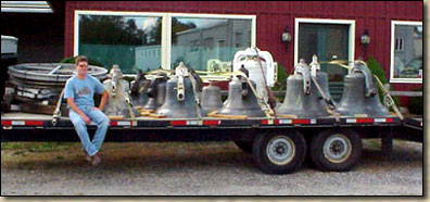 A flatbed truck filled with bells